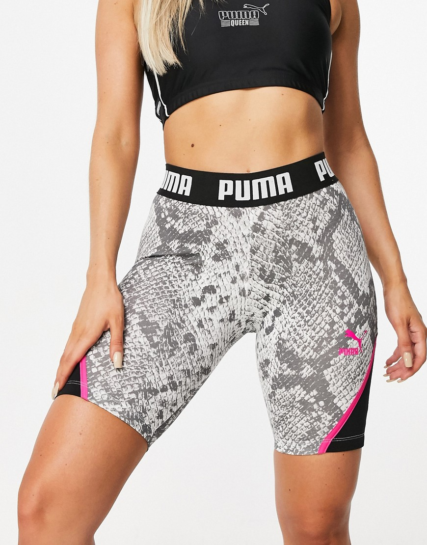 Shorts by PUMA Fresh gear, fresh motivation All-over snake print High rise Branded, stretch waist Co