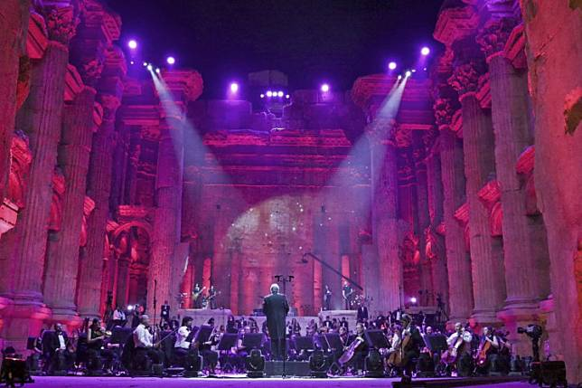 Maestro Harout Fazlian conducts rehearsals ahead of the Sound of Resilience concert inside the Temple of Bacchus at the historic site of Baalbek in Lebanon's eastern Bekaa Valley, on July 4, 2020.