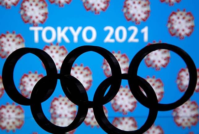A 3D printed Olympics logo is seen in front of displayed The International Olympic Committee (IOC) remains fully committed to staging the Olympic Games in Tokyo in 2021 and is considering multiple scenarios for them to take place safely,IOCPresident Thomas Bach said on Wednesday.