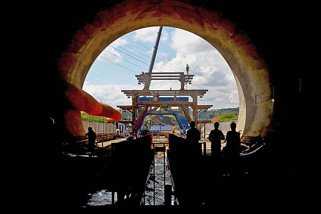 Into the light: Workers arrange equipment inside a giant tunnel built for the Indonesia-China high-speed railway project in Walini, West Bandung regency, West Java, on Feb. 21.