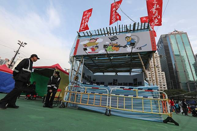 Hong Kong government acts after pro-democracy group refuses to remove banners mocking Chinese President Xi Jinping from stall at Lunar New Year fair
