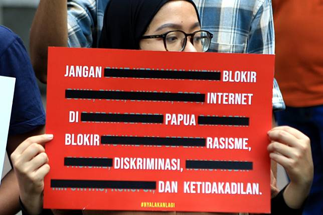 In solidarity: An activist holds up a poster during a demonstration in Jakarta on Aug. 23, 2019 to protest an internet blackout in Papua and West Papua imposed following riots in a number of the provinces' cities. The violence was a reaction to physical and racial abuse suffered by Papuan students in Surabaya, East Java.