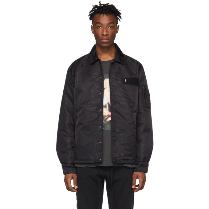 Long sleeve insulated nylon canvas jacket in black. Spread collar. Press-stud closure at front. Tona