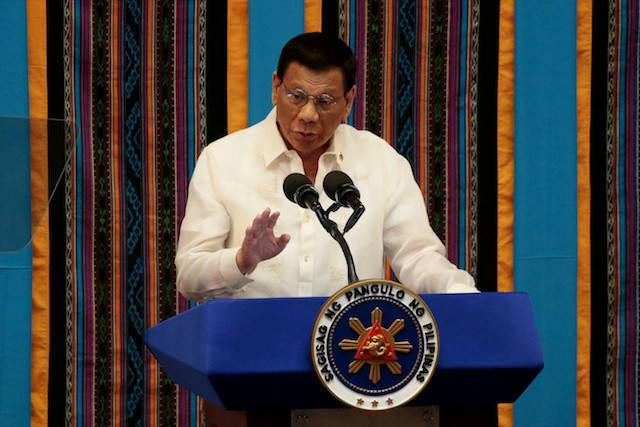 Philippine President Rodrigo Duterte gestures during his fourth State of the Nation Address at the Philippine Congress in Quezon City, Metro Manila, Philippines July 22, 2019.