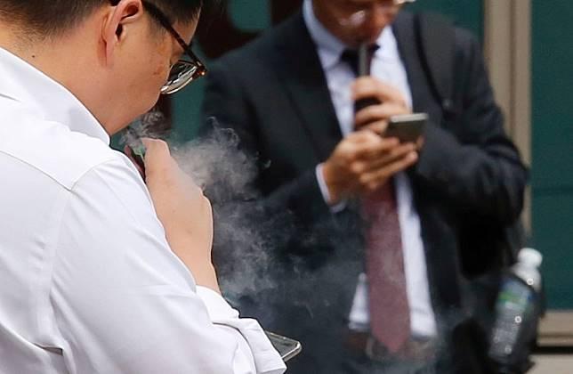 A man vapes in Seoul, South Korea, October 23, 2019.
