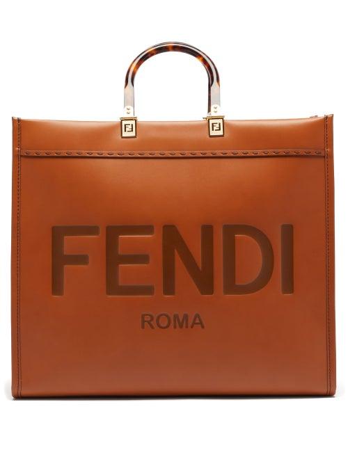 Fendi - The graphic debossed logo hallmarking Fendi's tan Sunshine tote bag pays homage to the house