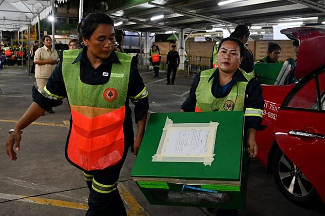 Ballot boxes are carried into a polling station in Bangkok on March 24, 2019 after polls closed in Thailand's general election.