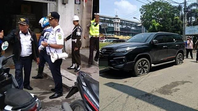 Dinas Perhubungan Gembosi Ban Toyota Fortuner yang Parkir Sembarangan  di Jalan Veteran, Medan, Sumatera Utara