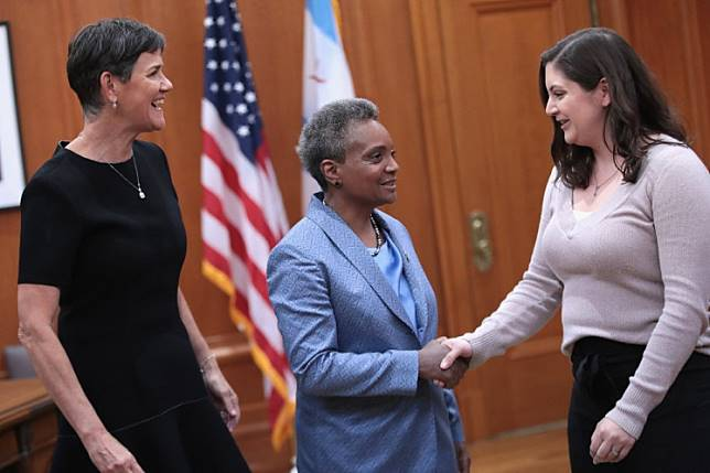 With her wife Amy Eshleman (L) by her side, Lori Lightfoot (C) greets guests at City Hall following her inauguration ceremony on May 20, 2019 in Chicago, Illinois. Today Lightfoot become the first black female and openly gay chief executive in the citys history.