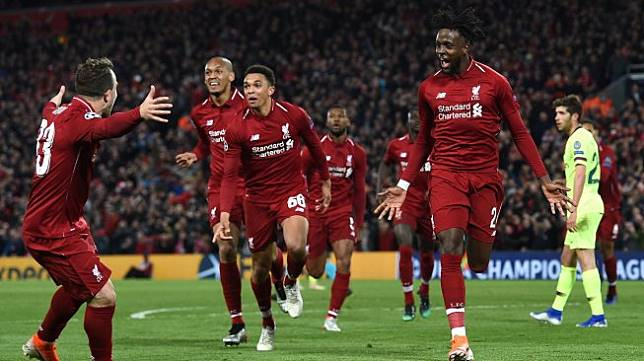 Pemain Liverpool merayakan gol ketiga mereka selama pertandingan sepak bola leg kedua semifinal Liga Champions antara Liverpool melawan Barcelona di Stadion Anfield, Liverpool, Inggris, Kamis (8/5) dini hari WIB.  [Paul ELLIS / AFP]