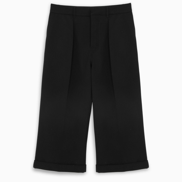 Flared trousers by Loewe in black wool featuring pleated design, cropped fit, belt loops on the fron