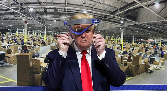 United States President Donald Trump holds up a protective face shield during a tour of the Ford Rawsonville Components Plant that is manufacturing ventilators, masks and other medical supplies during the COVID-19 pandemic in Ypsilanti, Michigan, US, on May 21.