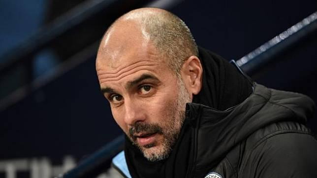 Manajer Manchester City, Pep Guardiola. [OLI SCARFF / AFP]