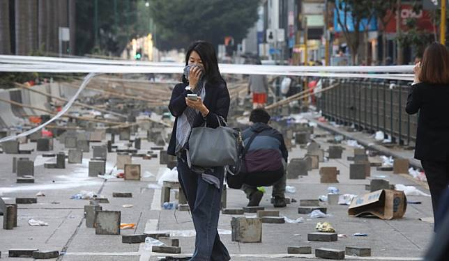 The busy Hong Kong tourist district dealing with the destructive aftermath of pitched battles between radicals and police
