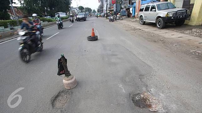 Korban Jalan Berlubang Bisa Tuntut Ganti Rugi, Seberapa Besar?