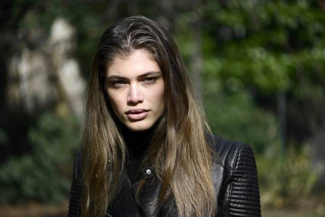 In this file photo taken on February 18, 2017 Brazilian transgender model Valentina Sampaio poses during an interview in Milan.