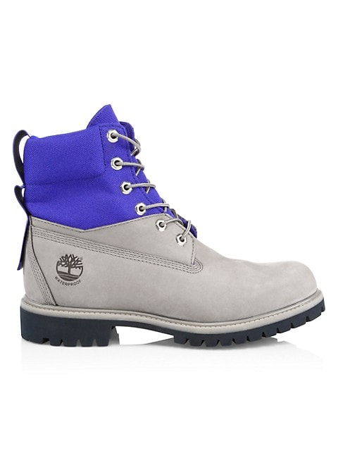 Rugged colorblock field boots feature a mixed-media waterproof design to lock out rain and puddles a
