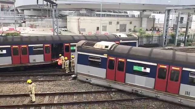 Emergency crew are seen at a derailed train wreckage near Hung Hom station on the MTR East Rail Line following an accident on a train bound for Mong Kok East in Hong Kong, China September 17, 2019 still image taken from a social media video. @SEELIFEHK