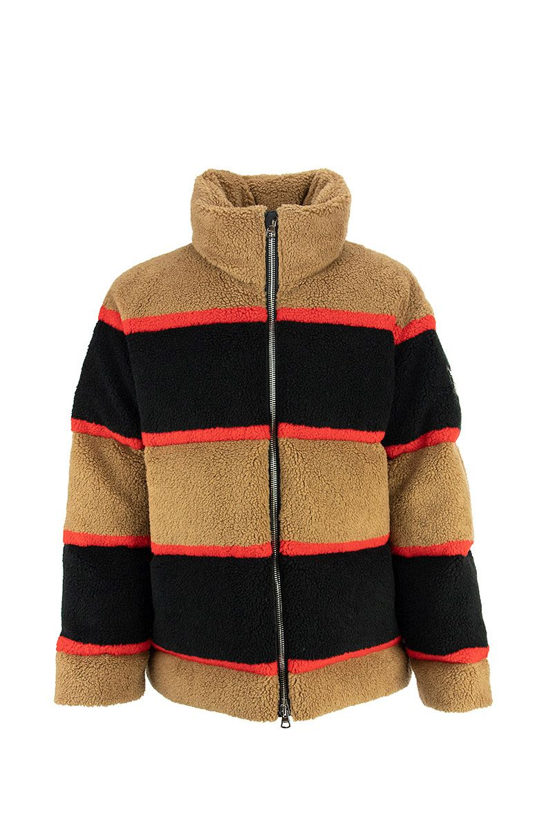 A funnel-neck puffer jacket reimagined in colour-block technical wool fleece, referencing our Icon s
