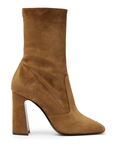 Saint Laurent - Supple tan leather lends Saint Laurent's Maddie ankle boots a retro mood. They're cr