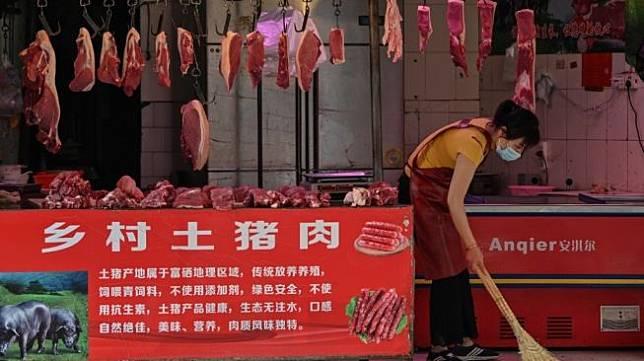 Pasar Wuhan, China. [Hector Retamal/AFP]