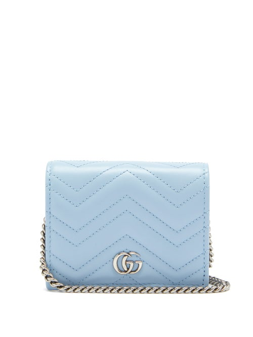 Gucci - Gucci's light blue Marmont wallet echoes the pastel theme of the house's Pre-AW20 accessories collection. The smooth leather has signature matelassé stitching in zigzags and outlining a logo on the back, and a neat fold-over front accented with silver GG hardware. Wear it via the chain strap, or remove it for a clutch option.