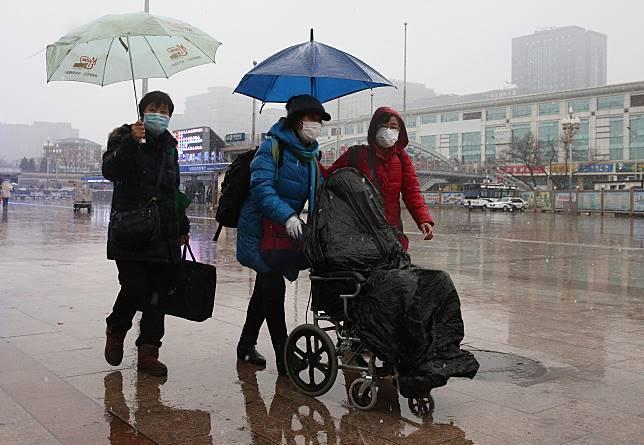 ▲武漢肺炎疫情料將再持續一段時間。圖為近日北京。(圖/美聯社/達志影像)