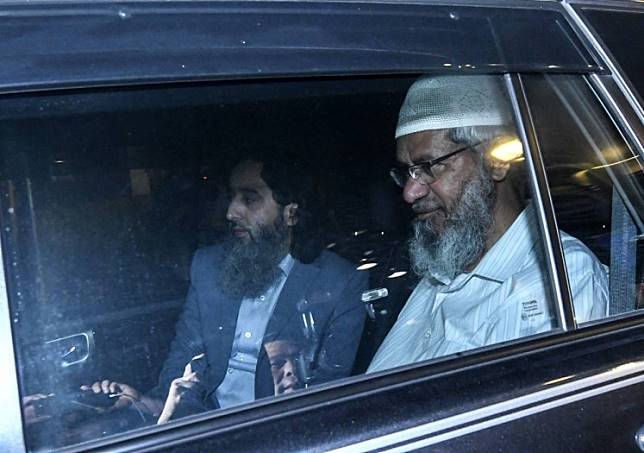 Zakir Naik (right) has come under fire for making racially sensitive remarks in Malaysia