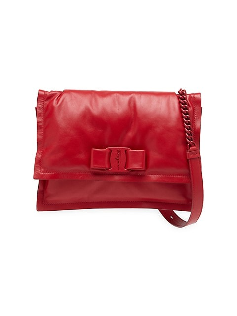Crafted of supple leather, this shoulder bag has an ultra-modern and on-trend padded finish.; Adjustable shoulder chain; Top flap with snap closure; Two interior zip compartments; Dust bag included; Leather; Lining: Leather; Made in ItalySIZE; 10.5