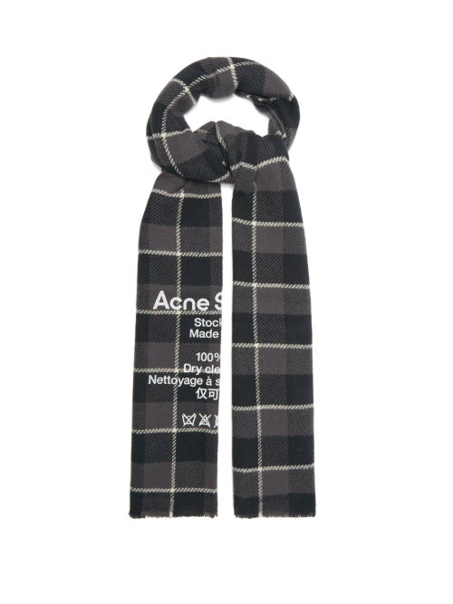 Acne Studios - Acne Studios' graphic inclinations are denoted by the bold white logo and care label printed on this black scarf. It's crafted in Italy from warm, soft wool with grey and white checks and finished with fringed ends. Wear it with a muted coat to stay warm as the weather cools.