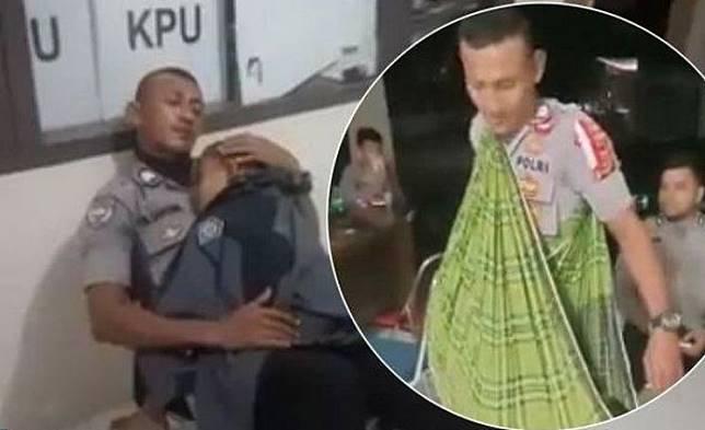 """Viral! Seorang Polisi Jaga Kotak Suara Sambil Gendong Anaknya, """"Ini Tugas Negara"""""""