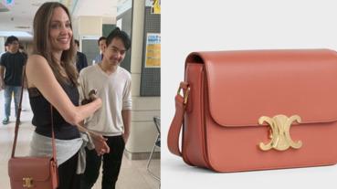 安潔莉娜裘莉揹磚紅色CELINE包,陪兒子Maddox參觀韓國延世大學!展現時髦媽媽穿搭