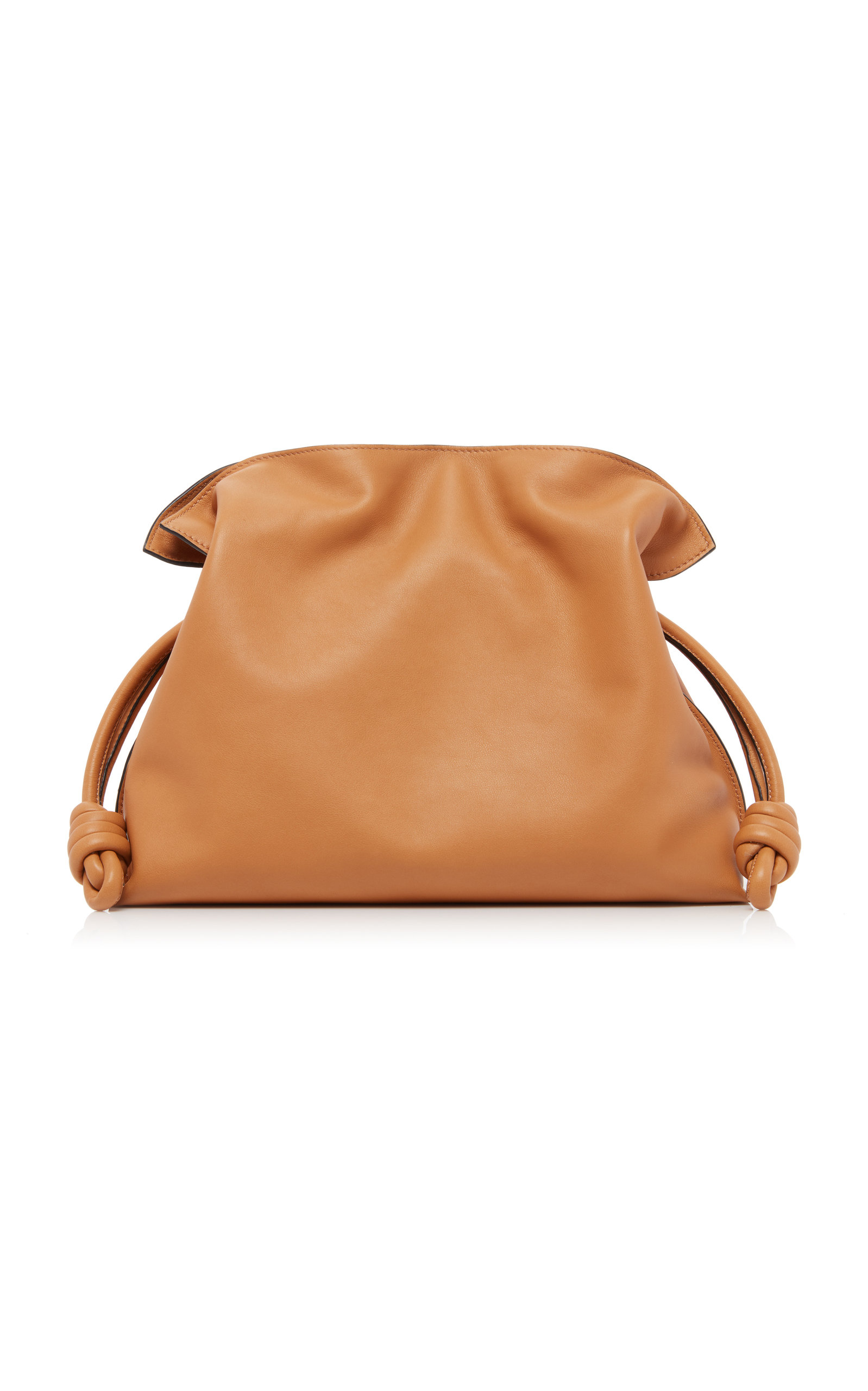 Loewe's impeccable craftsmanship is what makes its handbags among the most coveted. This 'Flamenco Knot' clutch has been made in the label's Spanish atelier from soft, supple Nappa leather to give it a slouchy silhouette that's perfect for holding daily essentials. Add the shoulder strap and adjust to the right length when you feel like carrying a crossbody.