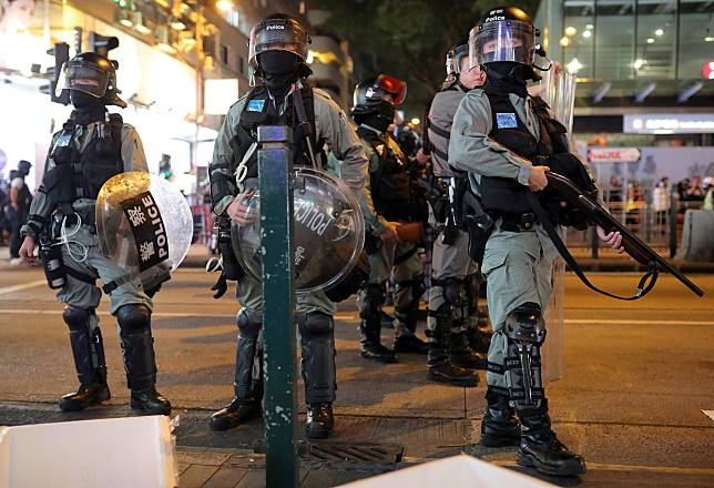 Riot police officers patrol after the