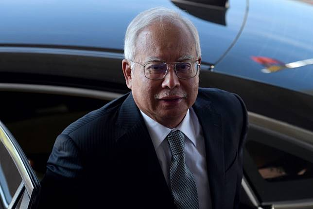 Malaysia's former prime minister Najib Razak arrives at the Kuala Lumpur High Court for his trial over 1MDB corruption allegations in Kuala Lumpur on April 15, 2019.
