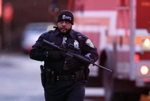 A Milwaukee police officer works the scene of a shooting at the Molson Coors Brewing Co. campus on Feb. 26, 2020 in Milwaukee, Wisconsin. Six people, including the gunman, were reportedly killed when an ex-employee opened fire at the MillerCoors building on Wednesday.