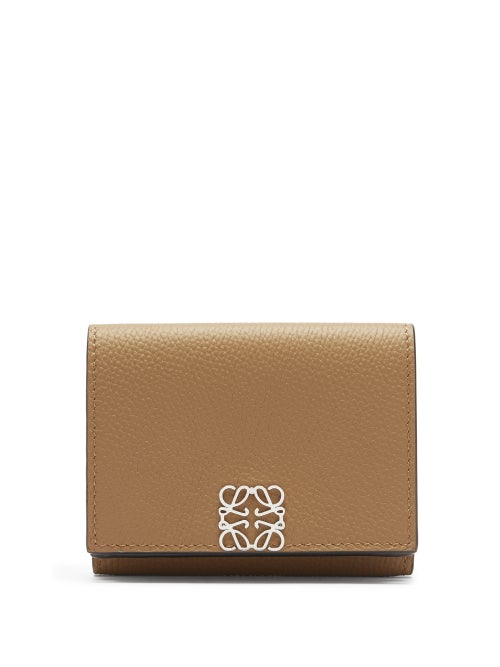 Loewe - Loewe's brown wallet is defined by the silver Anagram plaque that depicts a quadruple-L insignia, designed in 1970 by Spanish painter Vicente Vela and originally inspired by cattle-branding irons. It's made in Spain - the label's homeland - from grained leather framed by black lacquered edges and opens through a push-studded clasp into a tri-fold interior set with card slots and note compartments.