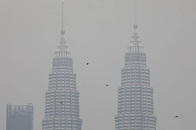 Petronas Twin Towers are shrouded by haze in Kuala Lumpur, Malaysia, September 9, 2019. Picture taken on September 9, 2019.