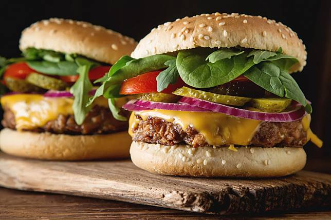Vegetarian burger with cucumber, tomato and lettuce