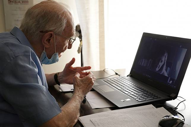 Giuseppe Paterno, 96, Italy's oldest student, takes his final exam online, for his undergraduate degree that he has been studying for in history and philosophy at the University of Palermo, using a laptop at his home, due to social distancing measures implemented during the coronavirus disease (COVID-19) outbreak, in Palermo, Italy, June 23, 2020.
