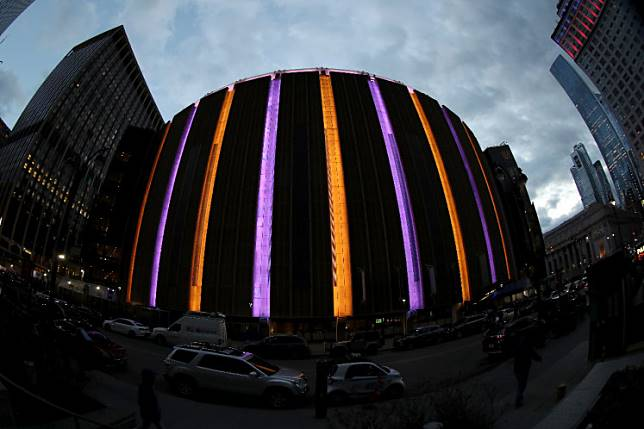 Gone too soon: Madison Square Gardens exterior lights were changed to purple and gold to honor NBA Legend, Kobe Bryant before the game between the New York Knicks and the Brooklyn Nets on Sunday at Madison Square Garden in New York City, New York.