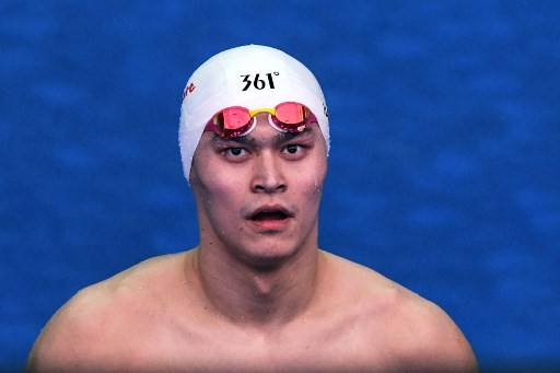 In this file photo taken on July 22, 2019 China's Sun Yang reacts after competing in a heat for the men's 200m freestyle event during the swimming competition at the 2019 World Championships at Nambu University Municipal Aquatics Center in Gwangju, South Korea. China's triple Olympic swimming gold medalist Sun Yang has been found guilty of refusing to give a doping sample and banned for eight years in an eagerly-awaited judgement from the Court of Arbitration for Sport (CAS) on Feb. 28, 2020.
