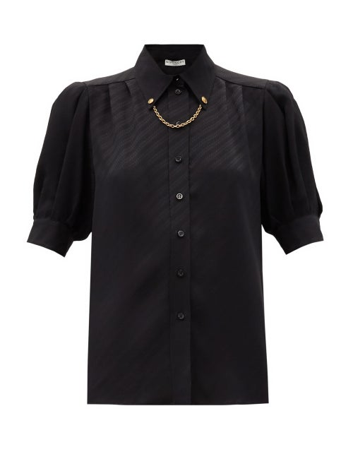 Givenchy - Givenchy's black blouse balances masculine and feminine sensibilities by juxtaposing clea