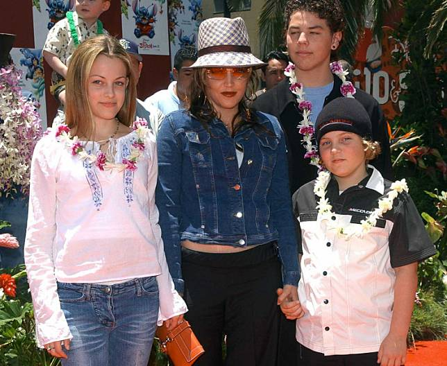 Lisa Marie Presley and her children Benjamin Keough (R), Riley Keough (L), and her half-brother Navarone Garibaldi (back) attend the premiere of 'Lilo and Stitch' at the El Capitan theatre in Hollywood on June 16, 2002.