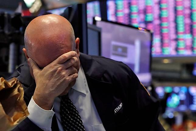 ▲全球陷入股災,美股 3 大指數皆跌入熊市。(圖/美聯社/達志影像)