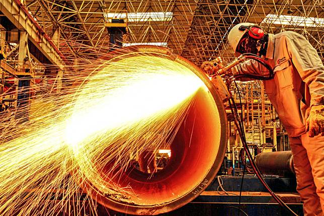 A worker cuts an oil pipe at a factory in Qingdao in China's eastern Shandong province on Thursday.Asia's factory pain showed signs of easing in June, as a rebound in China's activity offered some hope the region may have passed the worst of the devastation caused by the coronavirus pandemic.