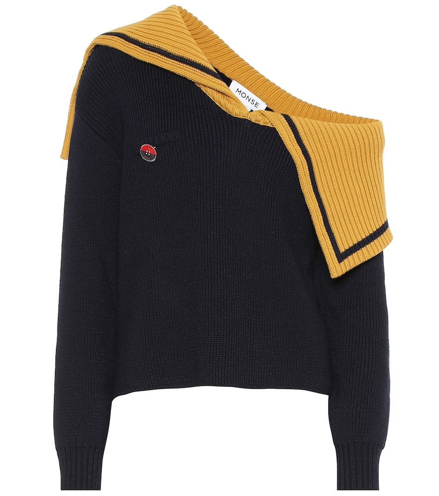 Monse applies its signature quirk to a classic sweater, crafting this navy blue design with a one-sh