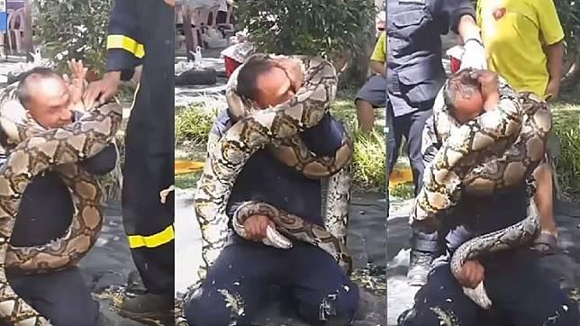 消防員示範掙脫蟒蛇,卻險遭勒斃。圖/翻攝自YouTube/Viral Press