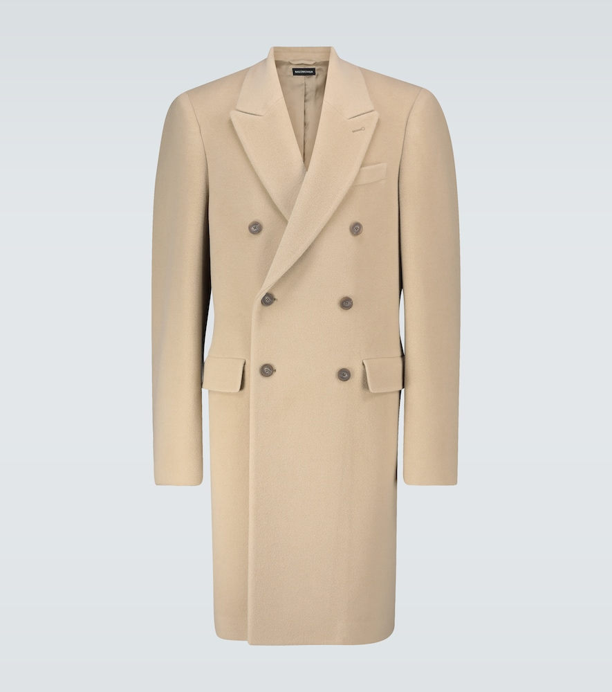 This oat beige coat from Balenciaga is made from a soft alpaca and wool blend, has oversized structu
