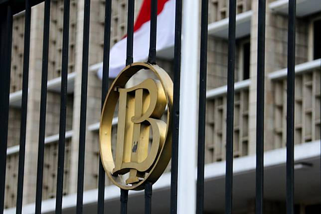The logo of Bank Indonesia (BI) marks the central bank's gate on Jl. Thamrin in Central Jakarta.